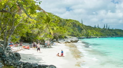 Lifou Island with Family Enjoying Private Beach Cove Stock Footage