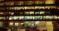 Office building viewed in the evening, with traffic, 4k, time lapse Stock Footage