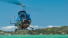 Bay of Islands Sightseeing Excursion Helicopter Landing in Paihia Stock Footage