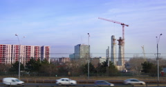 Building construction site with cranes and traffic in Bucharest, Romania, 4k Stock Footage