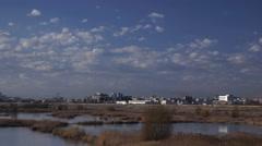 Bucharest, Romania - Vacaresti Natural Park, time lapse clouds Stock Footage