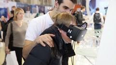 Boy uses virtual reality game development kit (virtual reality glasses) Stock Footage