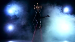 Attractive slim belly dancer go on dancing with candles, her head, black, smoke - stock footage