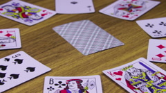 Playing Cards Rotates on a Wooden Table Stock Footage