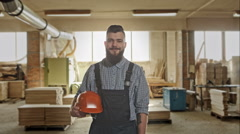 Happy young handyman carpenter in workshop, smiling. RAW video record Stock Footage