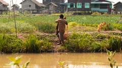 Fisher  cast a net near small river in Myanmar Stock Footage