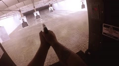 top view of loading pistol and shooting target ahead - stock footage