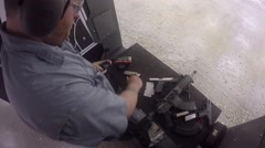 man reloading rounds into magazine - stock footage