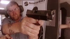 front view man shooting pistol at range - stock footage