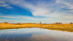 4k timelapse of flooded meadow with sky reflected in water Stock Footage