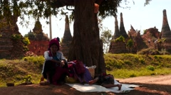 Poor Mother and son neat tree with old stupas background in Myanmar Stock Footage