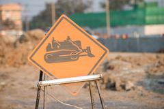 warning sign of construction vehicles - stock photo