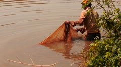 Fisher with fishnet in water in Myanmar closeup Stock Footage