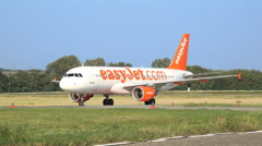 Easyjet airplane roll over runway Stock Footage