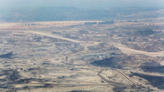 Mining dump trucks working in Lignite coalmine lampang thailand Stock Footage