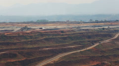Mining dump trucks working in Lignite coalmine lampang thailand - stock footage