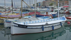 Classic wooden boats moored in Port Lympia in Nice Stock Footage