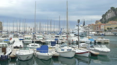 Sailboats anchored in Port Lympia on a cloudy day in Nice Stock Footage
