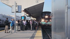 Train arriving during rush hour to LA Union Station platform - stock footage