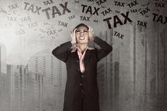 Asian business person thinking hard about tax Stock Photos