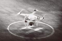 White drone going to take off Stock Photos