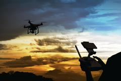 Male pilot controlling drone Kuvituskuvat