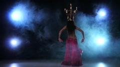 Belly dancer continue dancing with candles, her head, black, smoke, slow motion Stock Footage