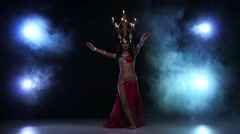 Belly dancer girl starts dancing with candles, her head, black, smoke, slow Stock Footage