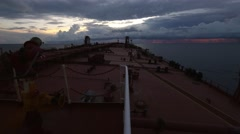 Sunset at sea, very large crude oil tanker deck pan Stock Footage