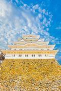 Himeji Jo Castle Stronghold Base Blue Sky Up V - stock photo