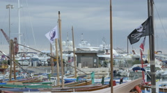 Flags on the masts of the boats moored in Port Lympia in Nice - stock footage