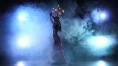 Belly dancer woman go on dancing with candles, head, black, smoke, slow motion Stock Footage