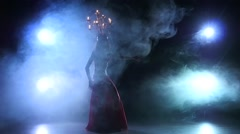 Slim belly dancer girl go on dancing with candles, head, black, smoke, slow - stock footage