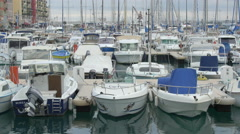 Sailboats moored in Port Lympia on a cloudy day in Nice - stock footage