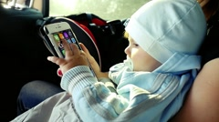 Toddler boy playing smartphone in the car in slowmotion at sunlight. 1920x1080 Stock Footage