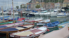 Colored row boats moored in Port Lympia in Nice Stock Footage