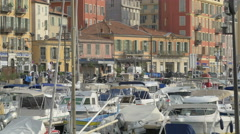 Walking and driving on Quai d'Entrecasteaux in the Old Harbor, Nice Stock Footage