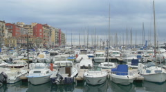 Boats moored in Port Lympia on a cloudy day in Nice Stock Footage