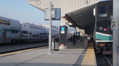 Rush hour passenger running to amtrak metrolink surfrider train Stock Footage