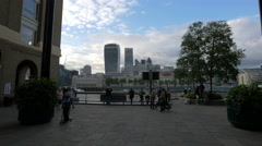 Tourists walking on the riverside in London Stock Footage