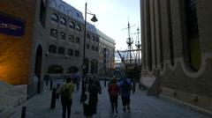 People walking towards Golden Hinde II museum in London Stock Footage
