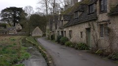 Historic Bibury Cotswolds England cottages stream 4K Stock Footage