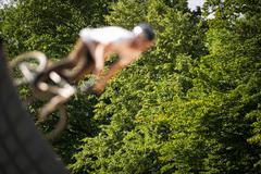 BMX Biker Performing Tricks during ride on a ramp Stock Photos