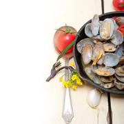 Fresh clams on an iron skillet Stock Photos