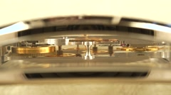 Luxury golden watch movement with glass side cover. Macro dolly shot - stock footage