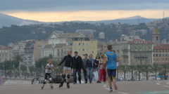 People walking, roller skating and jogging in the afternoon in Nice - stock footage