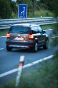 Blurred car on a highway (motion blur technique used to convey movement) Kuvituskuvat