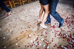 Couple dancing on a dance floor during a wedding celebration/party (motion bl - stock photo