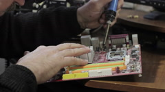 A soldering iron in his hands Stock Footage