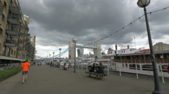 Running and relaxing near the boats moored on the riverside in London Stock Footage